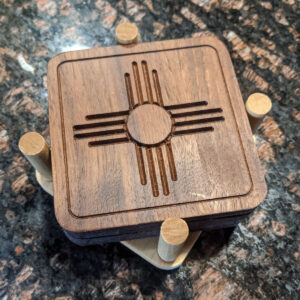Santa Fe Marketplace 4 Solid Walnut Wood Zia Symbol Coasters in Solid Hard Maple Holder