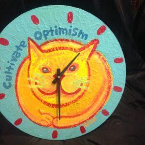 Santa Fe Marketplace Yellow cat clock Cultivate Optimism copyright Hillary Vermont